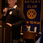 The Rotary Club meeting starts.