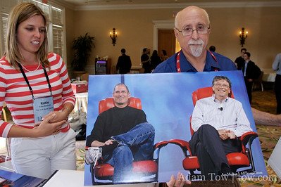 Walt Mossberg holds up a print of Steve Jobs and Bill Gates